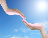 10018621-two-hand-touch-isolated-on-blue-sky
